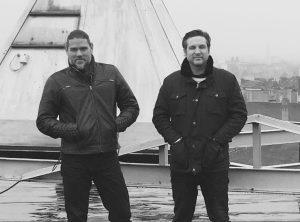 Olivier Boiscommun et Sylvain Runberg, sur le toit du bâtiment des Editions Le Lombard à Bruxelles.